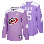 Camiseta Carolina Hurricanes Noah Hanifin Hockey Fights Cancer Violeta